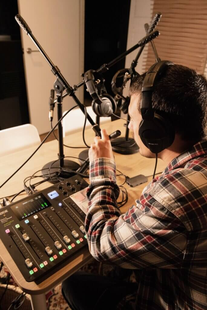 Client using the podcast studio at one76